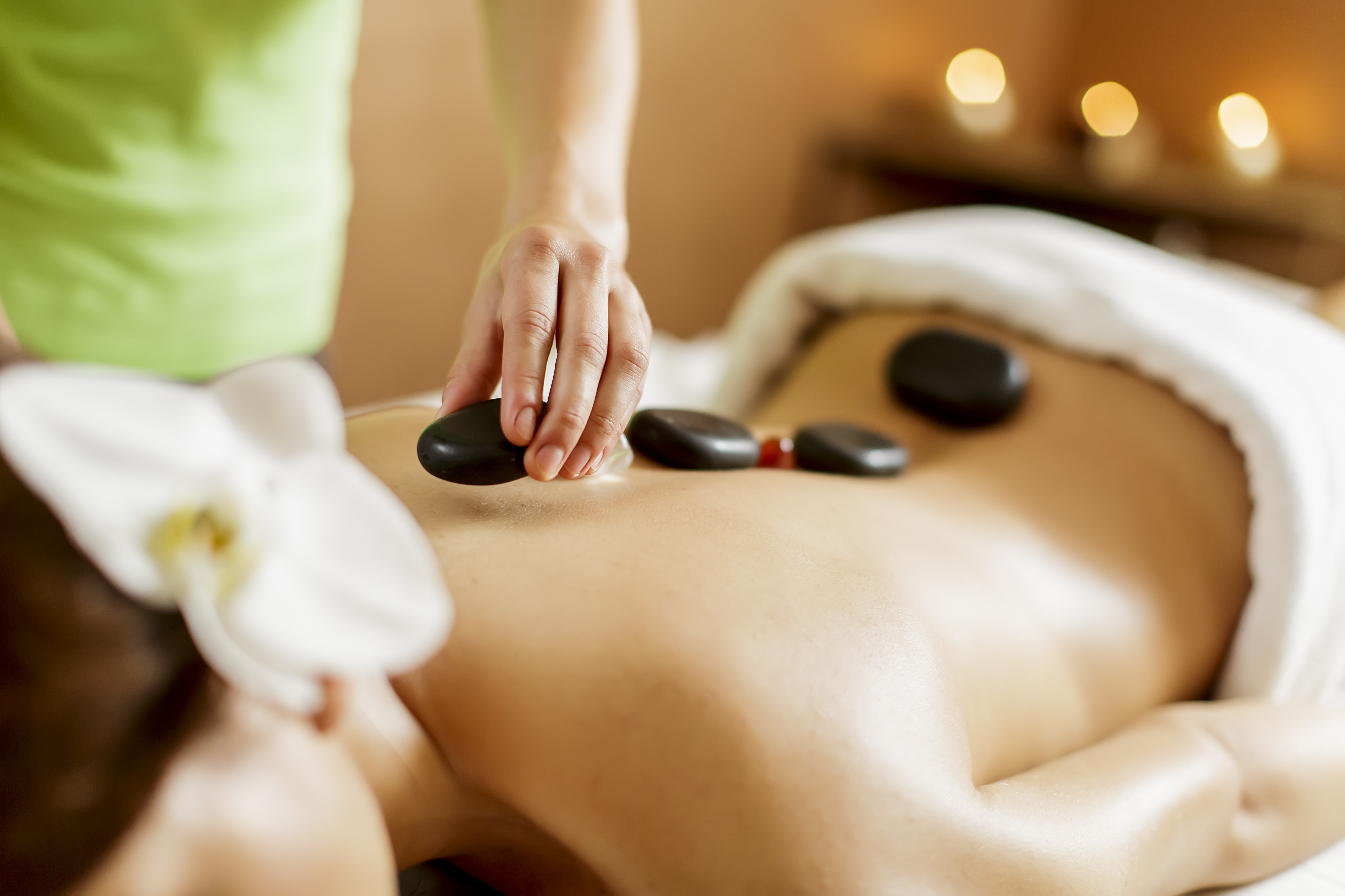 young-woman-having-hot-stone-massage-therapy